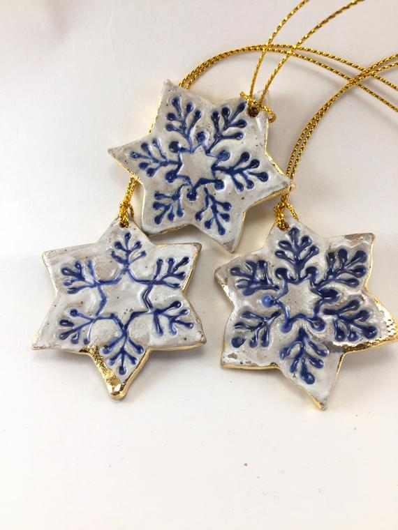 Three Blue and White Stoneflake Ornaments with Gold Edging